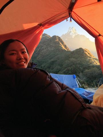 Tsechu Dolma in camping tent, with background of mountain scenes